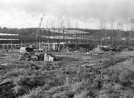 Construction of BCIT in progress; grass field and frame of building