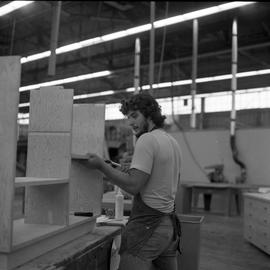 Carpentry apprenticeship contest, Burnaby campus, 1978 ; apprentice hammering a shelf