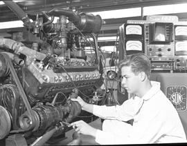 BCVS Heavy duty mechanic program ; a student working on an automotive engine