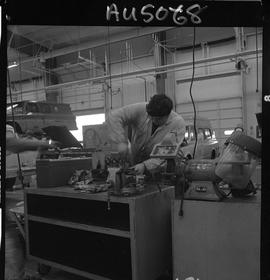 B.C. Vocational School image of an Automotive Mechanics program student working on a vehicle part...