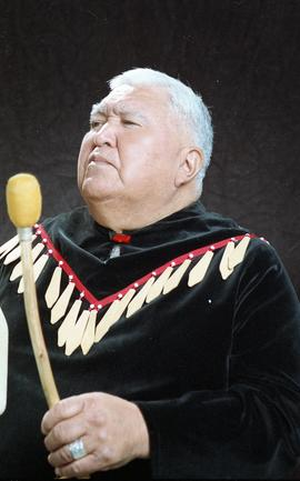 Bob George, First Nations elder, in First Nations garment playing an instrument [36 of 36 photogr...