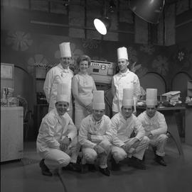 BCVS at Channel 8 TV; host and chefs posing for a picture