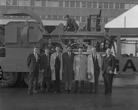 Forestry visit for Mr. Roper at BCIT on December 10, 1965; a group of men posing for a photo in f...