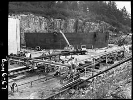 B.C. Vocational School image of the construction of a large steel petroleum tank