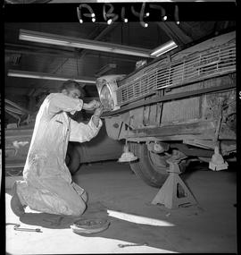 BC Vocational School image of Autobody program student working on a vehicle in the shop [1 of 5 p...