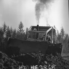 Heavy duty equipment operator, Nanaimo ; man operating a bulldozer moving dirt [6 of 9]