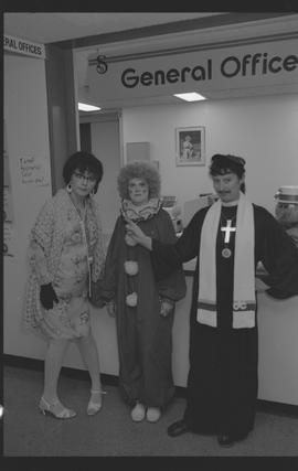 General Office staff dressed as a housewife (?), clown, and priest [3 of 11 photographs]