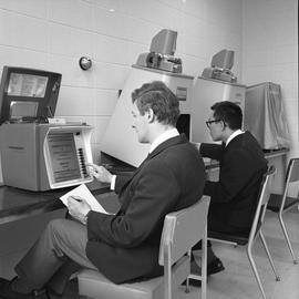 BCIT Library ; two students using microfilm readers [3 of 4]