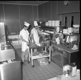 BC Vocational School Food Training Centre ; two students preparing food for the cafeteria