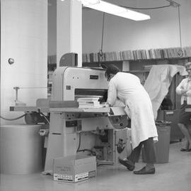 BCVS Graphic arts ; man using a machine to bind books