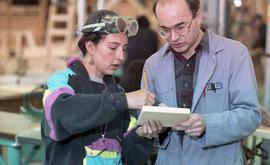 BCIT Women in Trades; carpentry, two people marking and measuring a piece of wood [6 of 6 photogr...