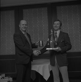 Hockey presentation, Plaza 500, 1972; player receiving the Sparling Trophy MVP award [1 of 2]