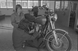 Pacific Vocational Institution ; a student working on a Yamaha motorcycle and the instructor watc...