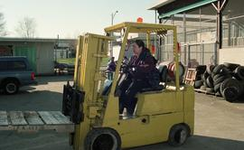 BCIT women in trades; forklift training, students driving a forklift [12 of 15 photographs]