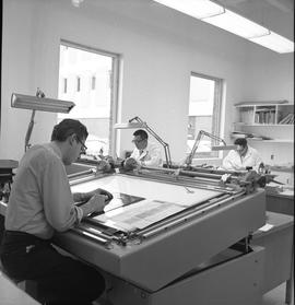 BCVS Graphic arts ; men working at desks