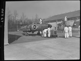BC Vocational School image of Aeronautics students working on a jet aircraft outside a hangar in ...