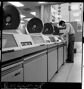BCIT Business Management image of a man working with a row of IBM 2311 computers