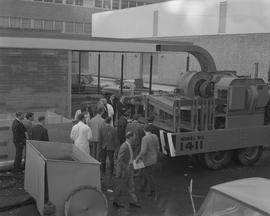 Forestry visit for Mr. Roper at BCIT on December 10, 1965; a group of men standing around a Barke...