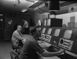 BCIT Broadcast and Television, 1964; three men working in a broadcast control room [1 of 2]