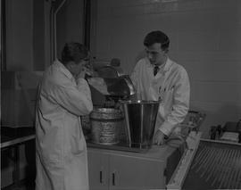 Mining, 1966; two men in lab coats testing mining samples [2 of 3]