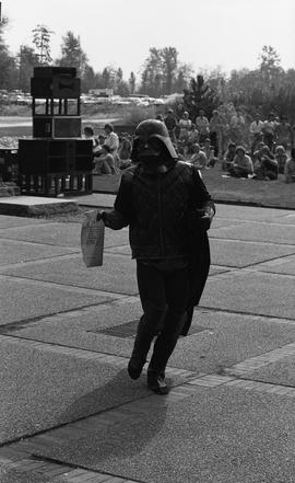 Person in Darth Vader costume with interoffice envelope at concert at Guichon creek