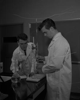 Food Processing Technology, 1966; two men wearing a lab coats performing a food processing test