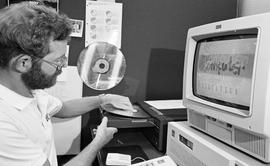 Computer Based Education (CBE)/Interactive Videodisc Project (IVD), Project publicity, man with c...