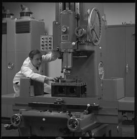Mechanical technology, 1968; man in a lab coat using a drill [1 of 2]