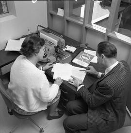 BCVS Graphic arts ; two people sitting at a desk and looking at paperwork [2 of 4]