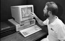 Man demonstrating using the touchscreen Interactive Videodisc (IVD) - The anatomy and physiology ...