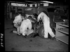 B.C. Vocational School image of Automotive program students working on a vehicle in the shop.