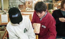 Trades discovery for women; carpentry, instructor (?) demonstrating tools to students inside a sh...