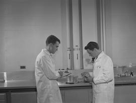 Food Processing Technology, 1966; two men wearing a lab coats performing a food processing test, ...