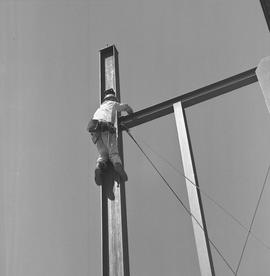 Structural steel, 1968; worker hanging onto a steel structure