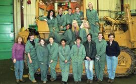 BCIT women in trades; heavy duty, students in uniforms standing in front of a bulldozer [2 of 9 p...