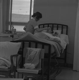 Practical nursing, Nanaimo, 1968; nurse checking a patient's temperature