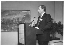 Alumni Association, 1987; George Madden speaking at a podium