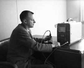 Instrumentation, 1964; man sitting at a desk using an ultrasonic flaw detector [2 of 4]