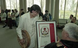 "BCIT open house '98, First Nations woman presenting a framed poster that reads ""BCIT First N..."