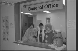 General Office staff dressed as a housewife (?), clown, and priest [11 of 11 photographs]