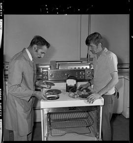 BC Vocational School image of an instructor and student in the Appliance Servicing program; stove...