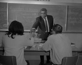 B.C. Vocational School image of a BTSD Basic Training program instructor teaching chemistry to tw...