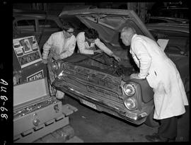 B.C. Vocational School image of an Automotive program instructor and students working on a vehicl...