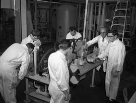 Mechanical Technology, 1966; six men in white overalls using machinery [2 of 2]