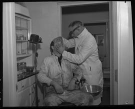 Industrial First Aid, Nanaimo; First Aid Attendant checking the eyes of an industrial worker