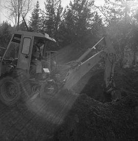 Heavy duty equipment operator, Nanaimo ; a man operating an excavator moving dirt