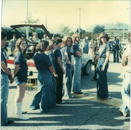 Student Rally 1984 ; students lining up next to a car