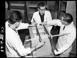 BC Vocational School image of a Carpentry Trades Instructor teaching two students in the Carpentr...