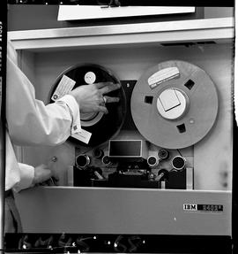 BCIT Business Management image of a man working with an IBM 2402 V magnetic tape drive.
