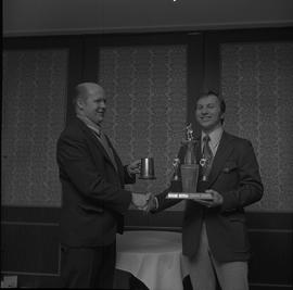 Hockey presentation, Plaza 500, 1972; player receiving the Sparling Trophy MVP award [2 of 2]